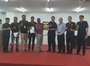 Choa Chu Kang NPC awarding Cluster 5 manager Mr Uma Sankar and his team the award for BEST Cluster Award 2018